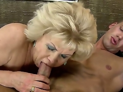 Golden-haired granny acquires nailed with a huge young throbbing penis after giving an awesome head