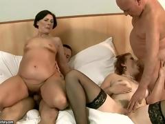 Margo T and Eodit are 2 sexually excited grannies that acquire their face holes and dripping soaked cookies fucked side by side. 2 fuck hungry oldies do it on a king size daybed in steamy foursome action!