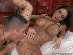 Attractive tanned black haired milf with round firm hooters and smoking hot body in fishnet full body nylons and high heels receives licked and boned to orgasm by young turned on buck