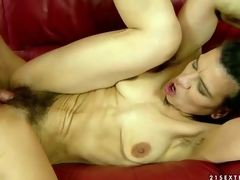 Slender dark haired older woman Susy receives turned up by young stud previous to she spreads her slim legs wide and receives her wet hirsute pussy filled with his hard dick. Watch slim granny get hard fucked