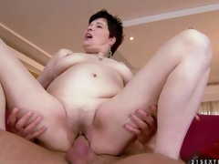 Goldee is a pale skinned short haired mature brunette hair with unshaved wet pussy. She has hardcore sex with her sexy blooded young fuck buddy and receives the enjoyment of her lifetime Watch mature slut get humped
