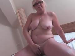 Undressed old chick masturbates her shaggy cunt