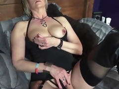 Darksome boots and lingerie on sexy golden-haired mature