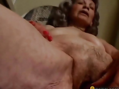 Woman lubricates sex toy