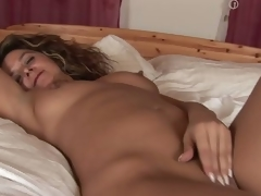 MILF Emanuelle masturbating in her sofa